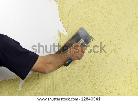 Constructor redecorating the house walls #12840541