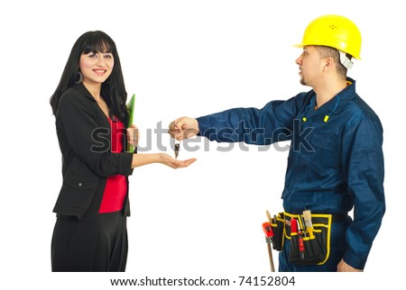 Constructor worker giving keys to a business woman isolated on white background