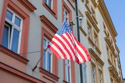 Consulate General of the Republic of United States. American flag on the building in Krakow, Poland