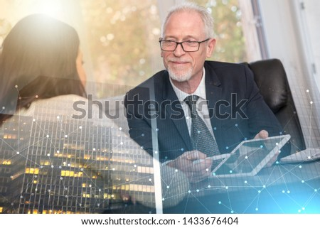 Consultant advising young woman at office; multiple exposure #1433676404