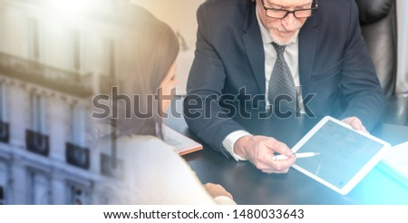 Consultant advising young woman at office; multiple exposure #1480033643