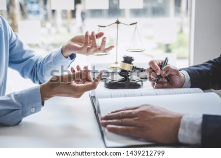 Consultation and conference of Male lawyers and professional businesswoman working and discussion having at law firm in office. Concepts of law, Judge gavel with scales of justice.