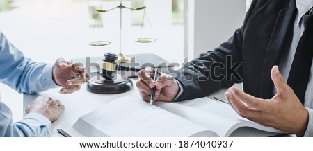 Consultation and conference of Male lawyers and professional businesswoman working and discussion having at law firm in office. Concepts of law, Judge gavel with scales of justice. Foto d'archivio ©