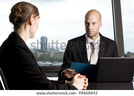 Consultation with male financial adviser in a nice office