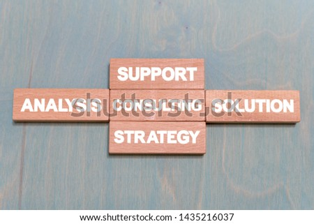 Consulting business finance concept on wooden rectangular blocks background. Consultant and advice service.