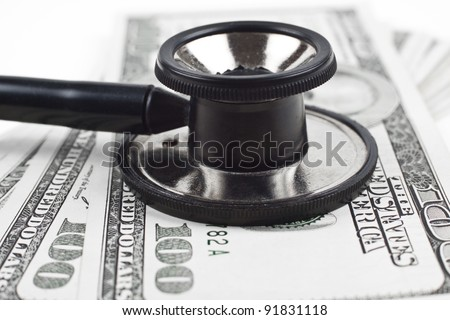 consulting dollars with a black thethoscope close-up on white background