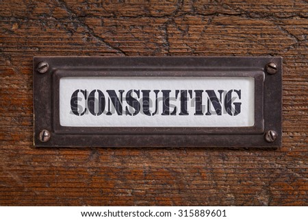 consulting - file cabinet label, bronze holder against grunge and scratched wood