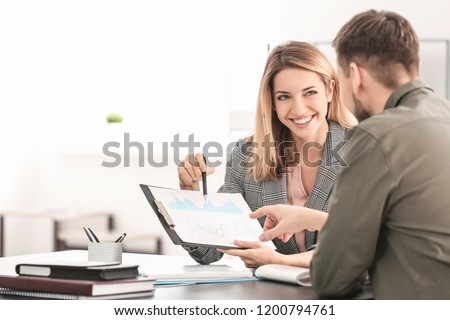 Consulting manager with man at meeting in office
