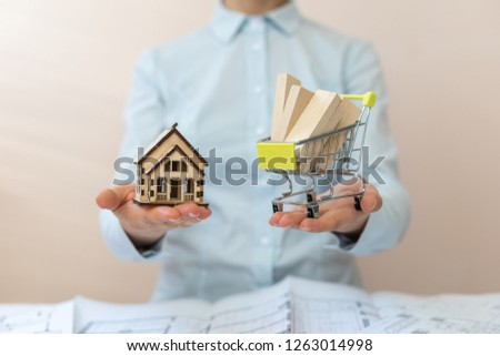 Consumer consumerism concept. Shipment delivery at your home! How much building material do you need to build a house? Lady in her formalwear shirt hold blocks for repair flat or apartment in building