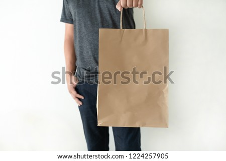 Consumer pack product Man shows bag mock up show