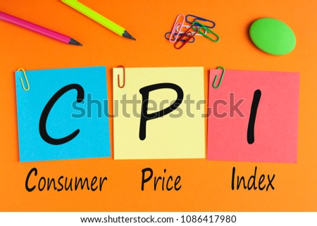 Consumer Price Index words with CPI written on written on color notes with and office supplies.  #1086417980