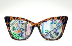 Consumerism, business and greed concept. Glasses and money