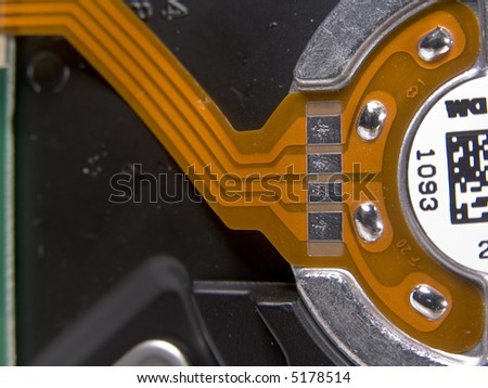 Contact pads on flexible circuit to control hard drive spindle