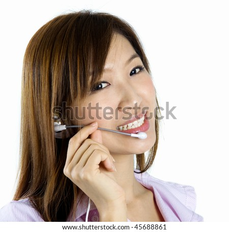 Contact Us! Friendly Customer Representative with headset smiling during a telephone conversation.