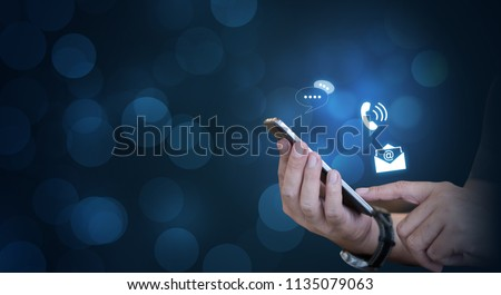 CONTACT US, Hand of a businessman holding a mobile smartphone with the icon. Contact us connection concept with copy space.
