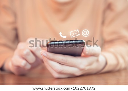 CONTACT US, Hand of woman holding mobile smartphone with ( mail,phone,email ) icon. cutomer support concept.