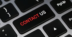 Contact us text on a keyboard. Feedback. Business concept.