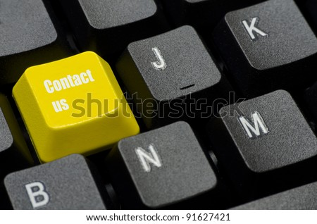 contact us words on yellow and black keyboard button