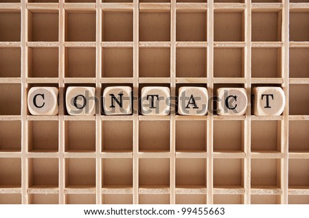 Contact word construction with letter blocks / cubes and a shallow depth of field