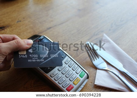 contactless payment card pdq background copy space with hand holding credit card ready to pay at cafe stock, photo, photograph, picture, image,