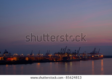Container are being loaded in the harbor of Hamburg