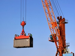 Container being lifted by a crane