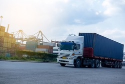 Container blue truck in ship port Logistics.Transportation industry in port business concept.import,export logistic industrial Transporting Land transport freight warehouse storge