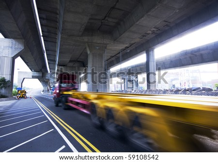container car fast moving under the freeway bridge