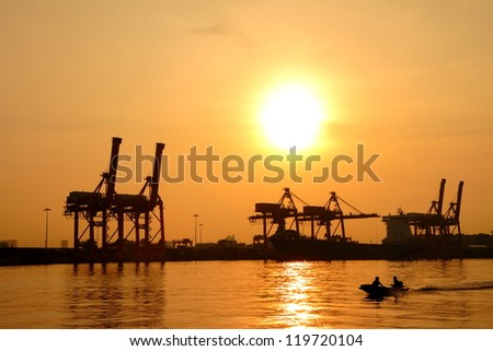 Container cargo freight ship silhouette in the morning, at Bangkok Thailand.