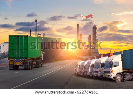 Container Cargo freight ship with working crane bridge in shipyard at dusk for Logistic Import Export background #622764161