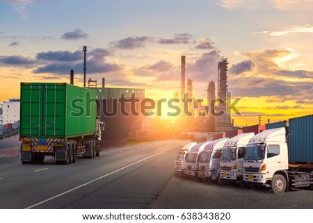 Container Cargo freight ship with working crane bridge in shipyard at dusk for Logistic Import Export background #638343820
