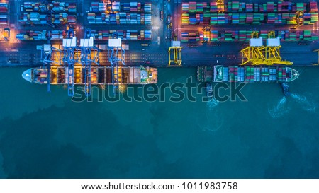 Container cargo ship in import export business logistic at night, Freight transportation, Aerial view. #1011983758