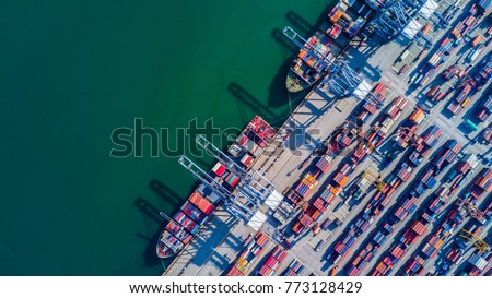 Container cargo ship loading at port, Freight transportation import export and business logistic, Aerial view.