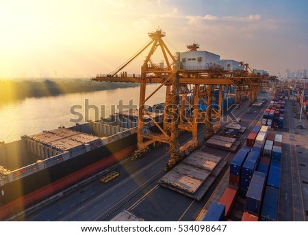 container,container ship in import export and business logistic.By crane ,Trade Port , Shipping.cargo to harbor.Aerial view.Water transport.International.Shell Marine.transportation.business,logistic.