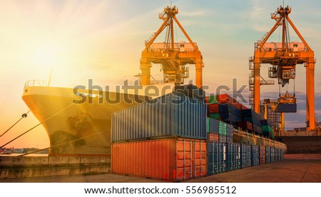 container,container ship in import export and business logistic.By crane , Trade Port , Shipping.Tugboat assisting cargo to harbor.