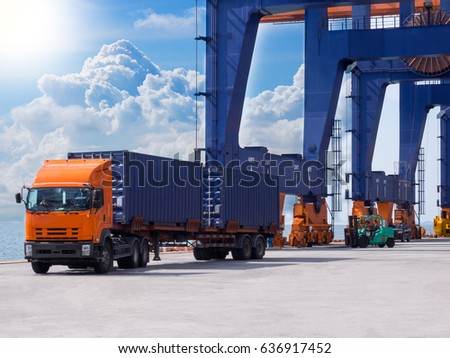 Container discharging from the vessel at the port move to container yard by truck #636917452