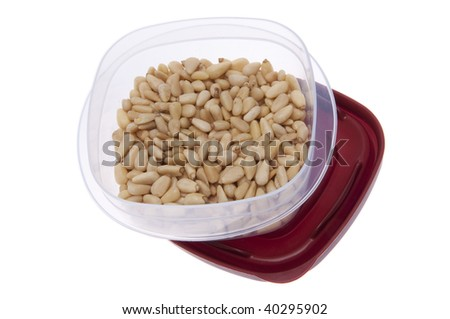 Container filled with leftover pine nuts.  A healthy snack.