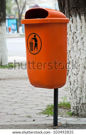 container for rubbish standing in public place
