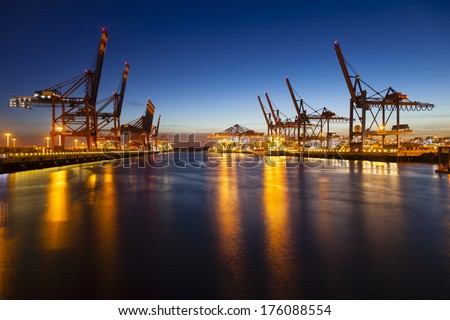 Container harbor at night in Hamburg Germany