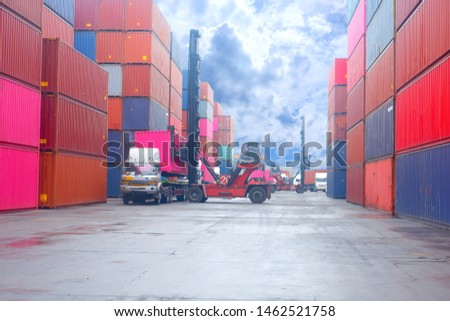 Container. Industrial crane loading Containers in a Cargo freight ship. Container ship in import and export business logistic company. Industry and Transportation concept