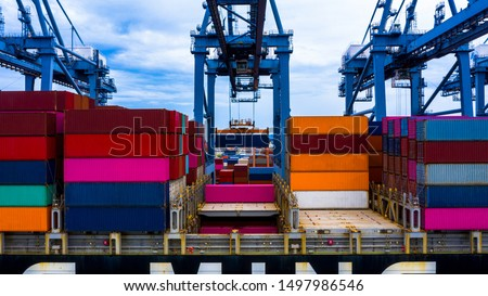 Container loading in a Cargo freight ship with industrial crane,  shipping in import and export business logistic company.