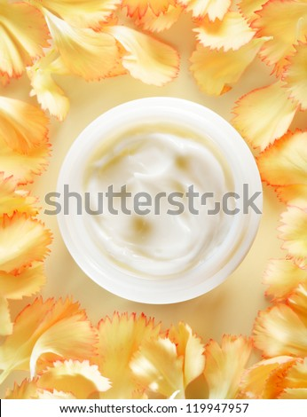 Container of cosmetic moisturizing with yellow flowers