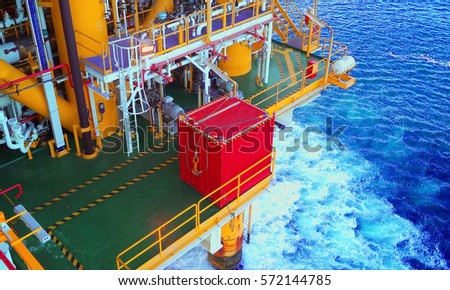 Container on lay-down area awaiting transfer to remote platform.