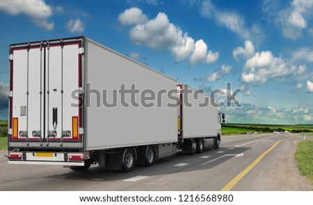 Container on the big highway. transport loads. Heavy traffic freight trailers on the highway. Cargo transportation #1216568980