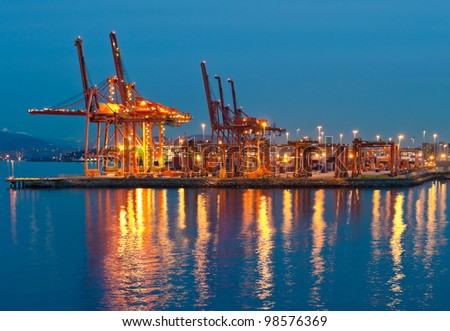 Container port terminal at disk (dawn, night ) in Vancouver,  BC