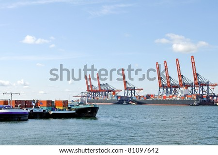 container ship and harbor cranes