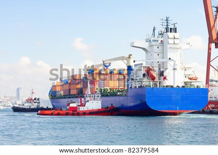 Container ship and tug boats