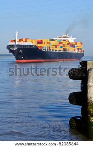 container ship approaching the harbor of antwerp