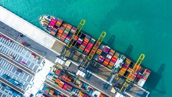 Container ship arriving in port, container ship loading at deep sea port, Logistic business commercial trade import export shipping and transportation, Aerial view, Dubai, United Arab Emirates.