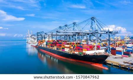 Container ship at industrial port in import export business logistic and transportation of international by container ship in the sea, Container loading in cargo freight ship with industrial crane.